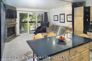Open kitchen, living, with plenty of storage