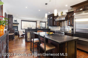 Open chefs kitchen with pantry, copper farm sink and Viking appliances.