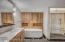 Subtle mosaic tile wall accents and tasteful light fixtures throughout