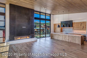 Soaring vaulted ceilings with floor-to-ceiling glass windows brings the outdoors in