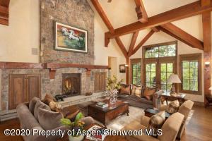 Featuring hand-hewn Douglas fir timbered beams and oak wood floors.