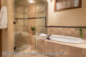 Featuring steam shower and jetted tub. Double vanities.