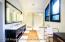 The elegant master bathroom has a steam shower and spacious closets.