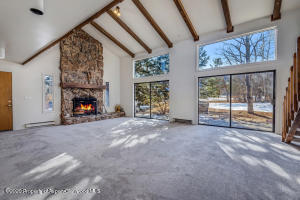 Natural light abounds with amazing fireplace to welcome you home