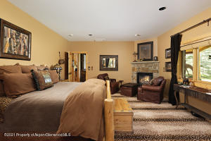 Guest master bedroom w/ fireplace