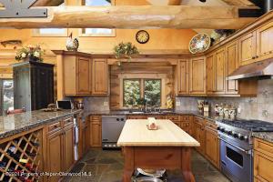 kitchen w/ beautiful wood cabinetry