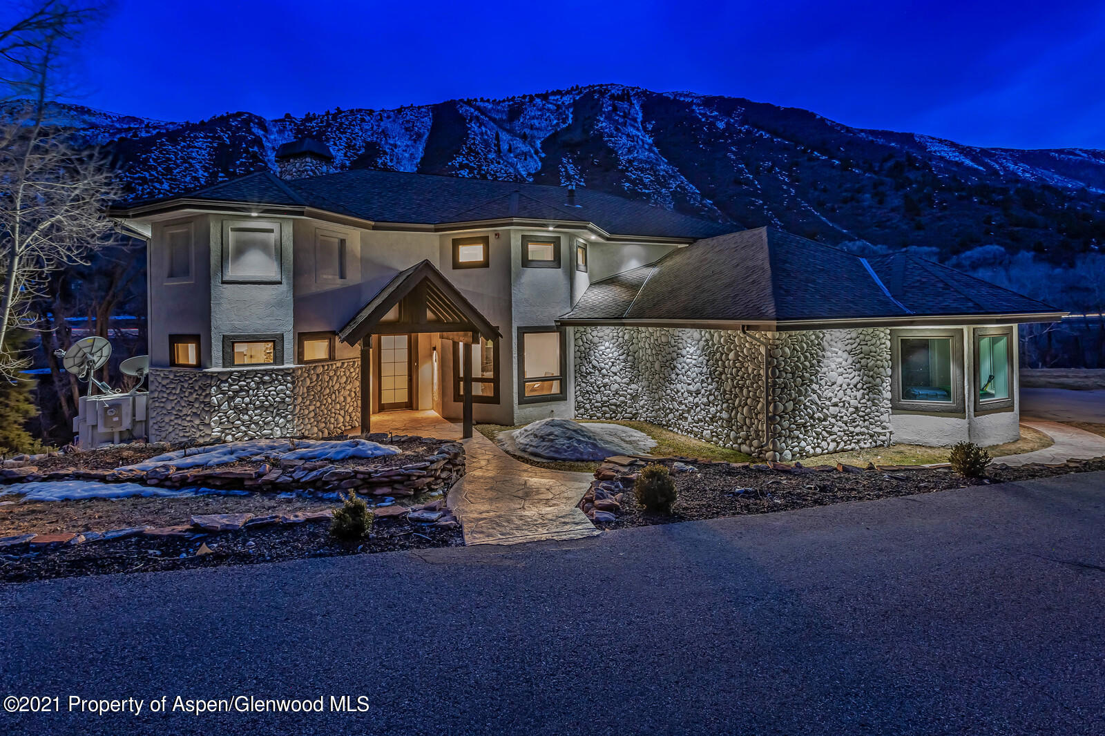 A rare refuge for fly fishing enthusiasts or a legacy mountain home for a family to enjoy for generations. Spacious riverfront home with a complete interior and exterior renovation in 2019. Move-in ready with fresh, clean interiors. The main level features an open floor plan, statement river rock fireplace, two dining areas, a den/bedroom and covered porch. The large top floor master suite features a bar area, private deck, gas fireplace  laundry room. On the lower level, entertain a large family or guests with 3 bedrooms, a theatre room, and an entertainment room. Private fishing access to exceptional fishing holes in the Roaring Fork River. No HOA. Excellent rental history. Located just 5 minutes to the Roaring Fork Club and 20 minutes to skiing and events in Aspen/Snowmass