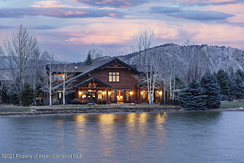 Colorado Mountain living at it's best in Aspen Glen. This majestic beauty sits overlooking a large peaceful pond and the 10th fairway. From the moment you enter you will feel right at home. Vaulted ceilings and hardwood floors are featured along with the massive stone fireplace. The open concept kitchen has top of the line appliances and a huge island just waiting to be gathered around. Decorated in mountain elegance this home is warm and inviting, offering room for all the friends and family. The main level master suite features its own fireplace with French doors leading to the patio hot tub. The master bath is outfitted in with a jetted tub, spacious shower and double vanity  finished in beautiful travertine and granite. Upstairs you are greeted with  a large open area that overlooks the main living area and works perfect as an office or library. On either side there are two comfortable guest suites each with their own private baths. The junior master has a its own skylights, a huge closet, additional storage and a sweet covered porch that faces west to capture the beautiful western sunsets. The lower level of this home invites you to relax in the theater room with a great movie or take one of the kids up on a game of ping pong in the game room. The lower level also features two comfortable bedrooms with a jack and jill bath as well as an additional half bath. You may never see the kids again once they venture below.