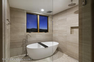 Enclosed wet room with bath and shower