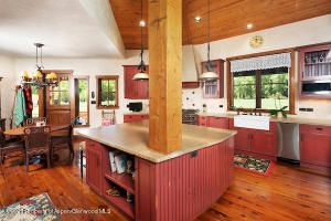 Kitchen with hardwood floors and sandstone counter tops