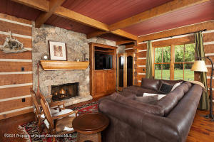 Cozy up to the gas burning fireplace