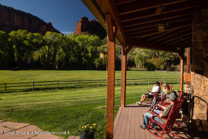 Enjoy sunset views from the back deck rocking chairs