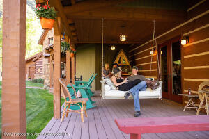 Front porch with swinging chair