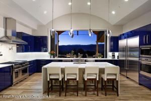 Gourmet kitchen open to porch
