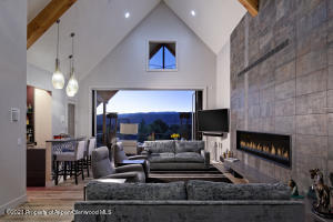 Living room -Beamed cathedral ceilings -Door walls open fully