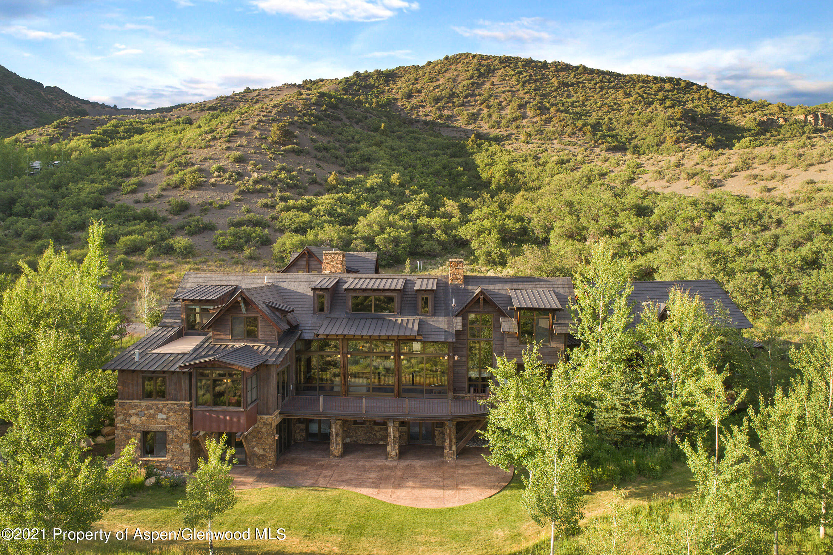 Never before offered: Hidden in the exclusive Pioneer Springs Ranch, with more than 13,000 square feet, this house is the ideal retreat. Offering both privacy and convenience, the 10-bedroom residence features an 8-bedroom main house with two well-equipped offices, an attached 2-bedroom apartment, and spectacular mountain views. Gourmet kitchen, butler's pantry with warming drawers, wine room, elevator, snowmelt, emergency generator, hundreds of square feet of storage, and even a spot to build a horse barn. The architecture is reminiscent of historic mining cabins, and the house was built with extensive stonework and reclaimed barnwood inside and out. Situated on 39 acres, only 10-12 minutes to downtown Aspen, less than 10 minutes to Aspen airport and Snowmass Village. Offered for $15,742.