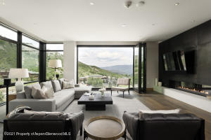 Main Living area with downvalley mountain views and accordian opening glass doors