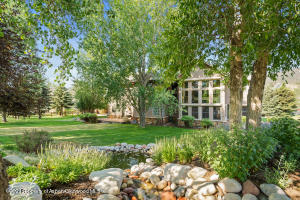 Enjoy the tranquility of the private backyard along the 18th fairway