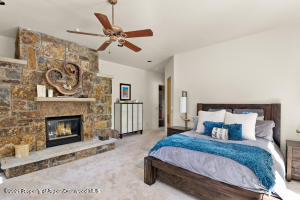 First floor Master Bedroom with beautiful stone fireplace
