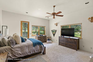 Master Bedroom with views to background and private entrance to patio