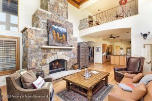 A soaring stone fireplace enhances the living area.