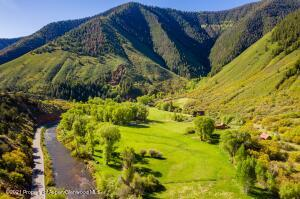 On 36 acres with 1200 feet of Frying Pan River
