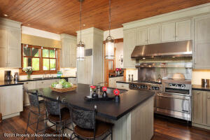 Kitchen features honed granite counters, 3 sinks, 2 dishwashers, gas range, and 2 refrigerators.