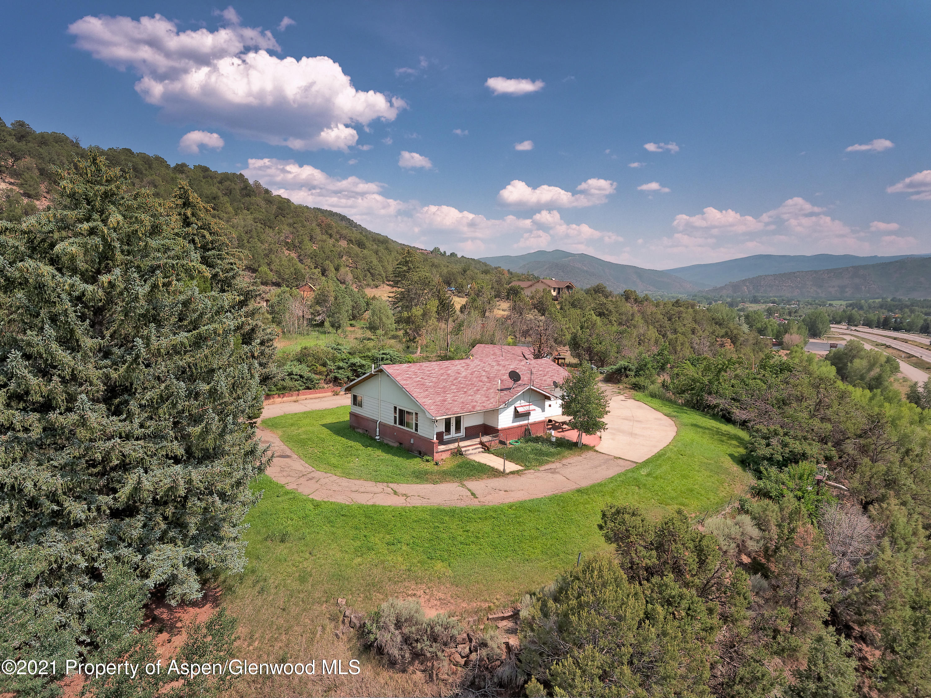 Boasting views up and down the valley, this home on the hill is poised with potential. Just shy of 7 acres, this property has abundant water and spring rights. Make it a horse property with corrals, a barn, and multiple buildings for vehicles and other storage. It can be your home today or re-imagine use of this property as a redevelopment opportunity. Prime access to HWY 82 and only a 4-minute drive to Willits town center, Whole Foods, City Market, and other shopping and services.