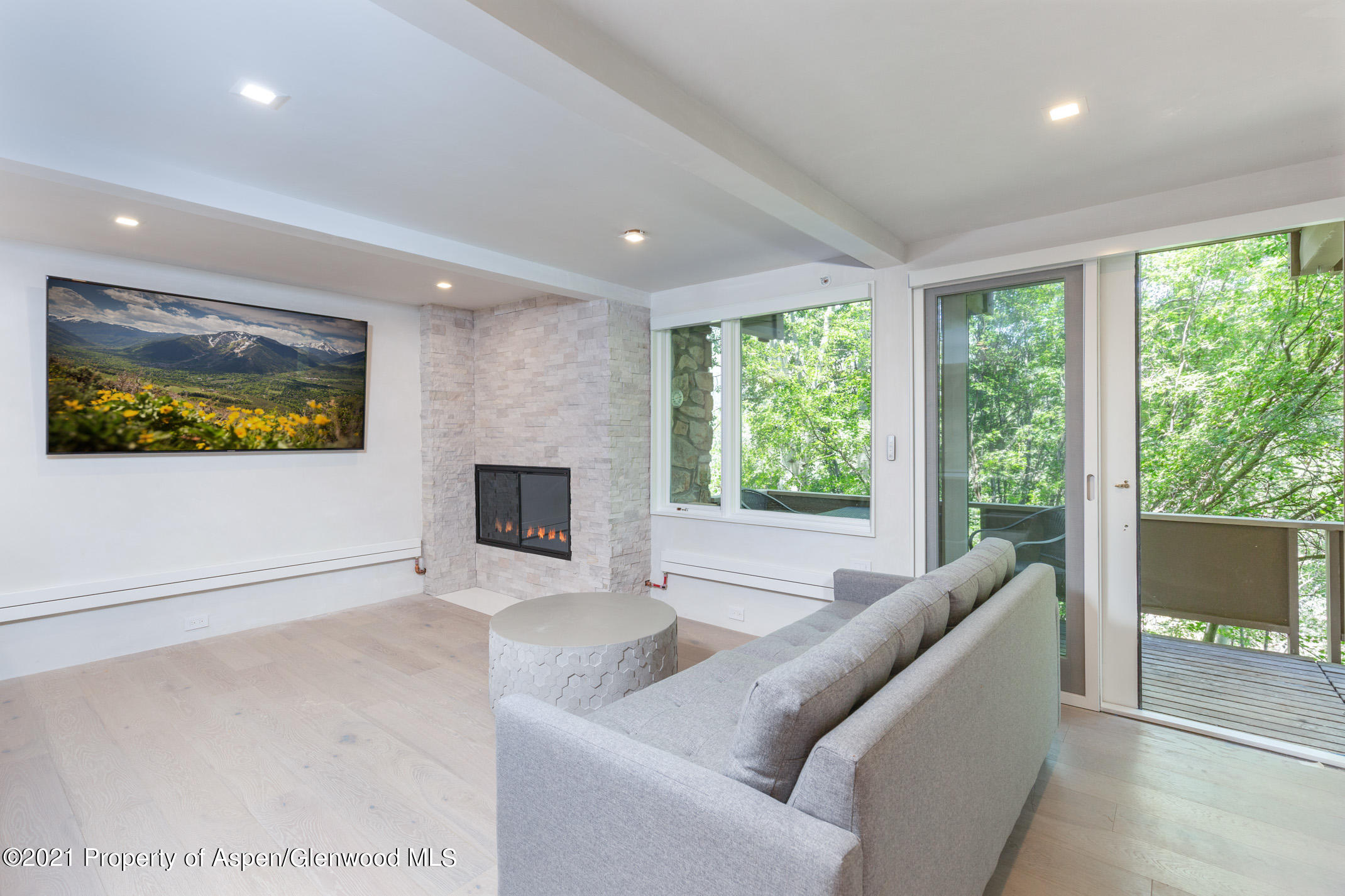 Stunning ''to the studs'' renovation of this 3 bed 3 bath ski in ski out condo at Aspen Alps. Steps to the Little Nell ski run, hotel and all of the extraordinary amenities downtown Aspen. Featuring custom finishes, fixtures, wood burning fireplace, Bosch appliances, caesarstone, two decks under a canopy of aspen trees with peekaboo views of smuggler and red mountain. Owners enjoy access to on-site fitness facility, tennis courts, outdoor pool, and health spa. Ownership includes front desk, generously sized owner storage, underground parking space. Completion anticipated November 2021.