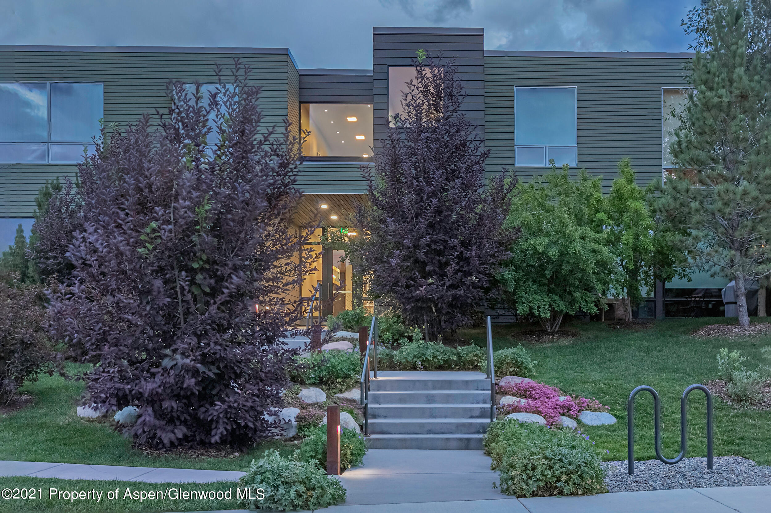 What everyone is searching for!  One floor living in the vibrant Willits/Park Modern community with floor to ceiling windows, 10 foot ceilings and a walk out patio that faces the seasonal stream and trees.  Lots of wall space for your art collection, 3 bedrooms and 3 baths, new flooring, new kitchen appliances, new showers in all of the baths,  gas fireplace with gorgeous marble surround, washer dryer,  two underground parking spaces plus storage and bike storage.  Lovely open areas for walking.  Filled with light, this lovely condo is ready for full time living and easy to lock up and leave.