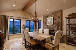 Dining Room with rustic fireplace