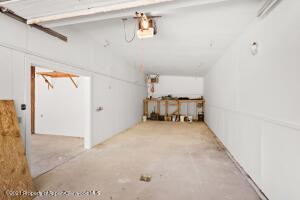 Extra large garage bay with washing area