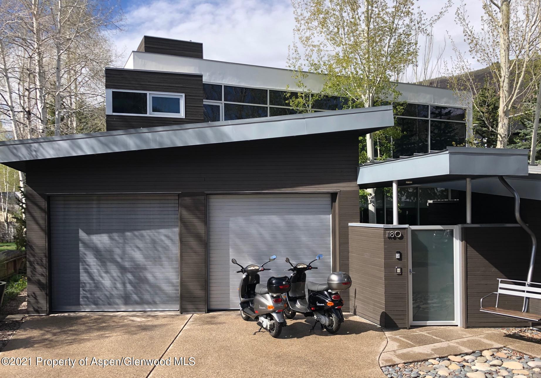 Fully furnished in-town ''turn-key'' modern single family, private gated home. Built entirely above grade the home may be expandable as there is approx. 900 sf of partially excavated basement.  The bedrooms have views of Aspen Mountain and in-suite bathrooms.  Private courtyard offers a stainless steel spa, cabana, fire pit, BBQ, and snow melt. Large commercially equipped gym opens to the courtyard.  Heated one car garage and a two car driveway with snow melt.  Southern exposure creates lots of light and snow/ice does not accumulate in front or in the courtyard.  Toto washlet toilets, programmable caseta lighting, easy to use audio visual and complete alarm system with cameras allow this single family home to be worry-free and low  maintenance.