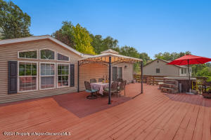 Spacious entertaining deck with views and jacuzzi