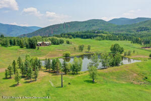 Here, you'll have 30 flat acres of privacy, views, and a large recreational pond to enjoy.