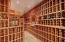 The 1,500-bottle wine cellar is conveniently adjacent to the speakeasy.