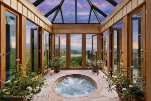 The master wing includes two separate bath areas and a large dressing room/closet.