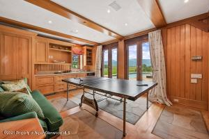Game room adjacent to gym in the master wing. Both rooms access the pool and hot tub.