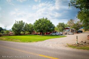 4.6 Acres, 4 Residences, His and Hers Outbuildings