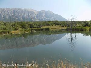 Fishing lake with Ragged Mountains in background.