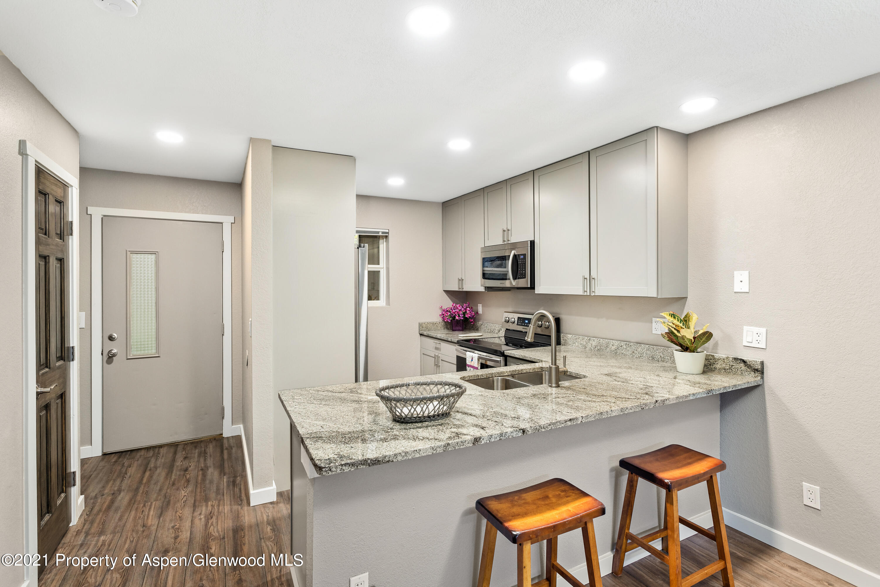 Everything has been remodeled in this perfect two bedroom end unit Oak Grove townhouse. The kitchen has been redesigned with new cabinets to the ceiling, solid granite countertops, can lighting and all new Samsung stainless steel appliances. All new doors and hardware, new heat registers, fresh paint, LVT plank flooring and new ceiling fans to complete the design. This unit has 2 covered parking spaces. All bathrooms have new vanities, completed tiled showers and new tub. Located 5-10 minutes from the Rio Grande and new mountain biking trails.