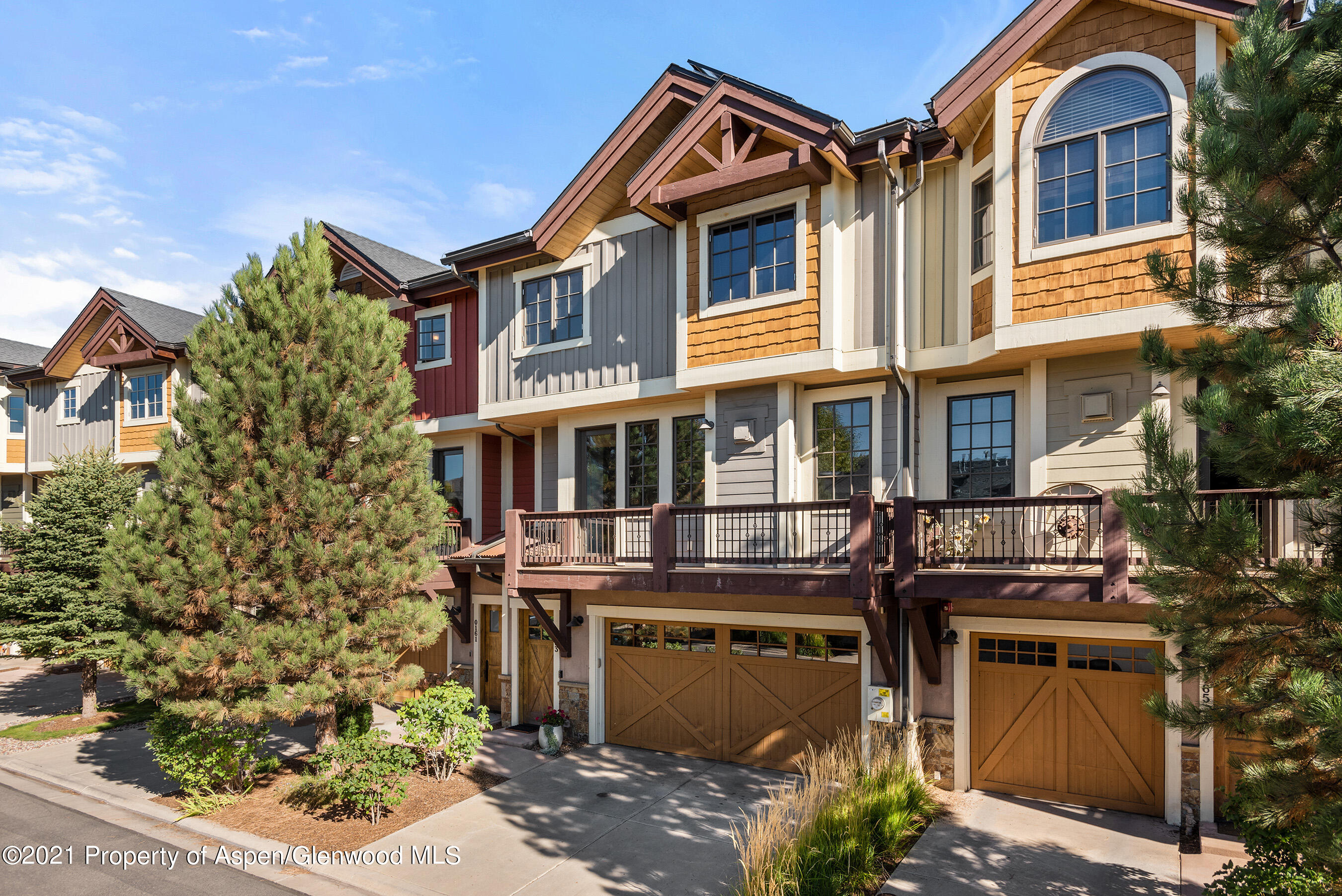 This well-maintained townhome is within walking distance from all the desirable mid-valley amenities:  shopping, dining, theaters, and Crown Mountain Park.  The main floor is ideal for tranquillity or entertainment with its open floor plan, kitchen island, back patio, fireplace, half bathroom, and peek-a-boo view of Mount Sopris.  Three bedrooms are located upstairs with two full bathrooms.  Additional features and upgrades in the dwelling include solar panels, wiring for an electric car charger, central air conditioning, a heated two-car oversized garage with abundant storage, and a garage sink. If you're looking for your permanent abode or a lock and leave, this is the perfect residence.