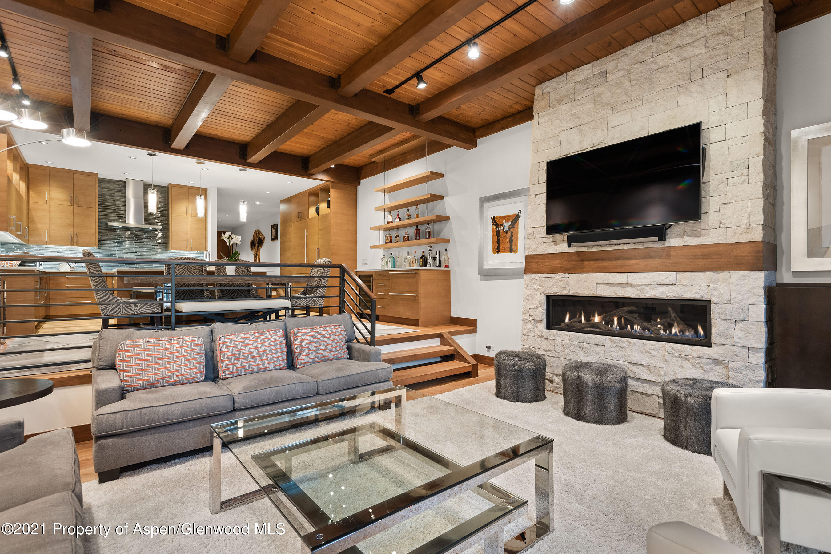 This ski access townhome was remodeled to the studs and offers an extraordinary mountain modern interior with high end finishes.  Ridge #10 is more than 2100 sq. feet, 3 bedrooms, and 3 bathrooms; in addition to reserved covered parking, and ample storage, there is space for everyone to enjoy the phenomenal location that comes with owning at the Ridge and the sought after ''Upper Phase'' which is adjacent to the ski access trail, pool and spa.   The warm and inviting spacious rooms, vaulted upstairs ceilings, and designer furnishings make this a true luxury townhome experience in the heart of Snowmass Village.