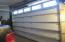 9 ft door to large warehouse/garage/shop area