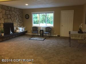 Large living room w/fireplace, new carpet and fresh paint.