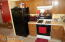 Kitchen has newer refrigerator and counter microwave stay