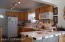 Lovely kitchen with full appliance package and ceramic tile counters and backsplash.