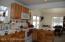 Another view of kitchen to dining area