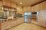 Exceptional kitchen with multi height hickory cabinets Viking Cooktop and double ovens