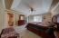 Master suite features coffered ceiling with fan and private bath and walk-in closet